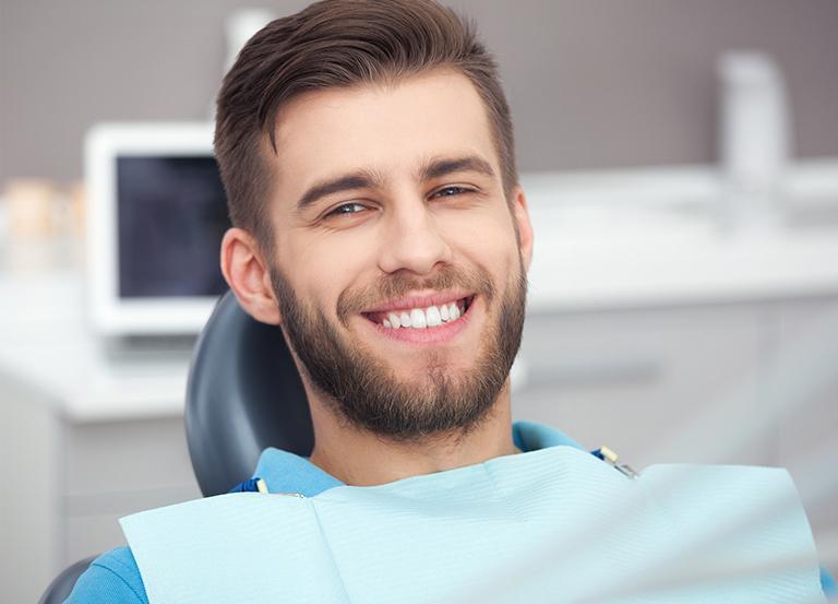 Uśmiechnięty pacjent